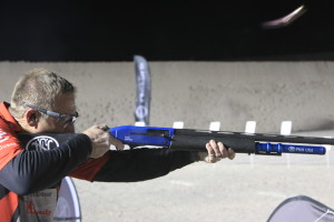 The shotgun being used by this pro shooter features and extended magazine tube allowing him more shots before reloading.